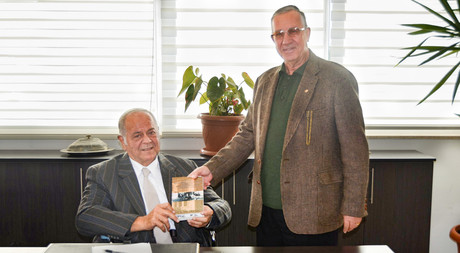 EMU-ATUM Chair Presents New Book to Acting President of EMU Board of Trustees
