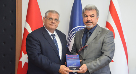 Asst. Prof. Dr. Göktürk Presents His New Book to Prof. Dr. Necdet Osam